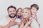 Family Photo Portrait. Four Relatives Are Hugging On The White Background, Smiling, At Home, Blond M poster