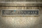 Queens walk inscription in London.  Queens Walk takes you over Westminster Bridge, along the south poster
