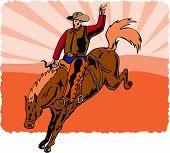 foto of bucking bronco  - Retro style vector art of a cowboy riding a bronco - JPG