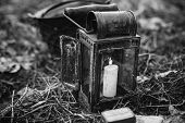 Old German Wehrmacht Times Of World War Ii Vintage Lantern With Burning Candle On Forest Ground. Pho poster