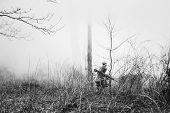 Re-enactor Dressed In Overcoat As World War Ii Russian Soviet Red Army Soldier Running In Fog Smoke  poster