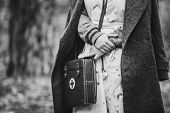 Re-enactor Wears Historical German Nurse Paramedic Of World War Ii Uniform With First Aid Kit. Photo poster