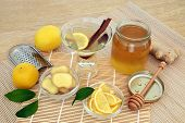 Healing flu and cold remedy ingredients with fresh ginger, lemon fruit, cinnamon sticks and honey wi poster