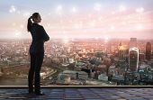 Young Woman Looking Over The City Of London Business And Banking Aria With Skyscrapers At Sunset. Fu poster