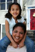 image of mixed race  - A mixed race mother and daughter playing outside - JPG