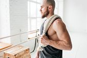 Portrait Of Fit Man With Battle Ropes At Cross Gym. Strong Male Athlete Holding On Shoulder Rope Aft poster