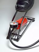 picture of air compressor  - A foot operated air pump in use.
