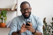 Happy African American Businessman Using Phone Mobile Apps At Workplace poster