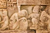 stock photo of lice  - Ancient Khmer carving of lice being picked out of a woman - JPG
