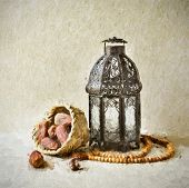Holy month of Ramadan -an artistic image. Dates and lantern. A fine art image in oil- painting treat poster