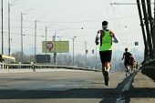 Strong Runners Running On City Bridge Road. Running On City Bridge. Marathon Running In The Morning  poster