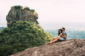 A Couple In Love On A Rock Admires The Beautiful Views. Boy And Girl On The Rock. A Couple In Love T poster