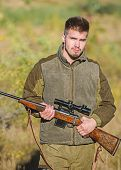 Bearded Serious Hunter Spend Leisure Hunting. Man Brutal Unshaved Gamekeeper Nature Background. Hunt poster