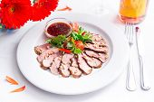 Tasty Sliced Roast Duck Breast With Fresh Vegetable Salad And With Cranberry Sauce. Peking Duck Beas poster