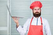 Delivery Service. Chef Laptop At Kitchen. Culinary School. Hipster In Hat And Apron Buy Products Onl poster