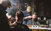 Barber With Clipper Trimming Hair On Nape Of Client. Hipster Hairstyle Concept. Hipster Client Getti poster