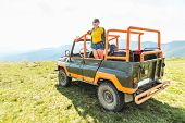 Happy Laughing Woman On Suv Car In Mountains. Off Road Trip Concept poster