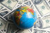 Dollar Banknotes Background And A Globe Model. World Control. Control Of Financial System. poster