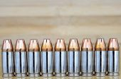 foto of hollow point  - 9mm hollow point bullets as abackgroung pattern - JPG