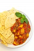 stock photo of chipotle  - Delicious Peach Mango Salsa with chipotle Chips - JPG