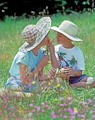 stock photo of playmate  - A young boy and girl wearing wide - JPG