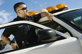 picture of 35 to 40 year olds  - Police Officer Leaning on Patrol Car - JPG
