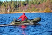 Green, Powerboat, Inflatable Rubber Boat With Motor On Wood Lake.