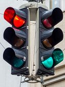 a traffic light with red and green light at an intersection
