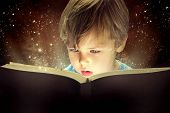 stock photo of little kids  - Child opened a magic book - JPG