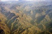 aerial view of mountains from jet flight