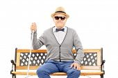 pic of blind man  - Blind senior man seated on bench isolated on white background - JPG