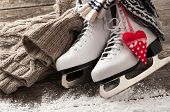 pic of skate board  - White ice skates on old wooden boards