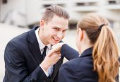 picture of politeness  - Young businessman greet polite his partner with kissing hand - JPG