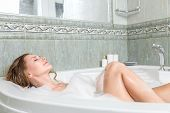 pic of bubble-bath  - Young beautiful woman relaxing in a bath - JPG
