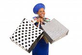 stock photo of traditional attire  - excited black woman in traditional clothes holding shopping bags - JPG