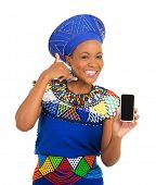 stock photo of zulu  - happy african woman doing call me sign and holding smart phone - JPG