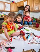 pic of babysitter  - A Family spending time together in kitchen - JPG