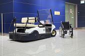 foto of buggy  - Wheel chair and buggy in airport terminal - JPG