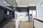 picture of kitchen appliance  - Modern new kitchen with stylish stainless appliances - JPG
