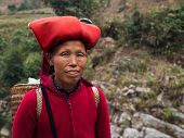 stock photo of hmong  - Woman from Red Dao minority group wearing traditional headdress near Ban Ho village - JPG