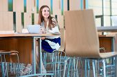 stock photo of canteen  - Girl studying with ipad in the University canteen - JPG