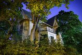stock photo of house woods  - Spooky old haunted house at night in H - JPG