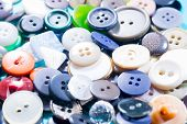 stock photo of orifice  - the background of a large number of buttons closeup - JPG