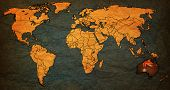 foto of flags world  - australia flag on old vintage world map with national borders - JPG