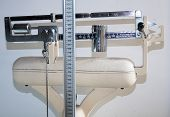 stock photo of measuring height  - old bathroom scale with measuring rod for the height and the weight counterbalance - JPG