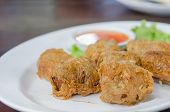 foto of crab-cakes  - deep fried crab meat roll cake on white dish chinese food - JPG