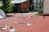 image of baby spider  - Set of red chain swings on modern kids playground - JPG