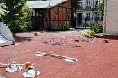 stock photo of baby spider  - Set of red chain swings on modern kids playground - JPG