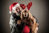 picture of beast-man  - Badass Santa with dog as Santa - JPG