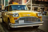 picture of cabs  - A great old historic Yellow Cab on an urban city street - JPG